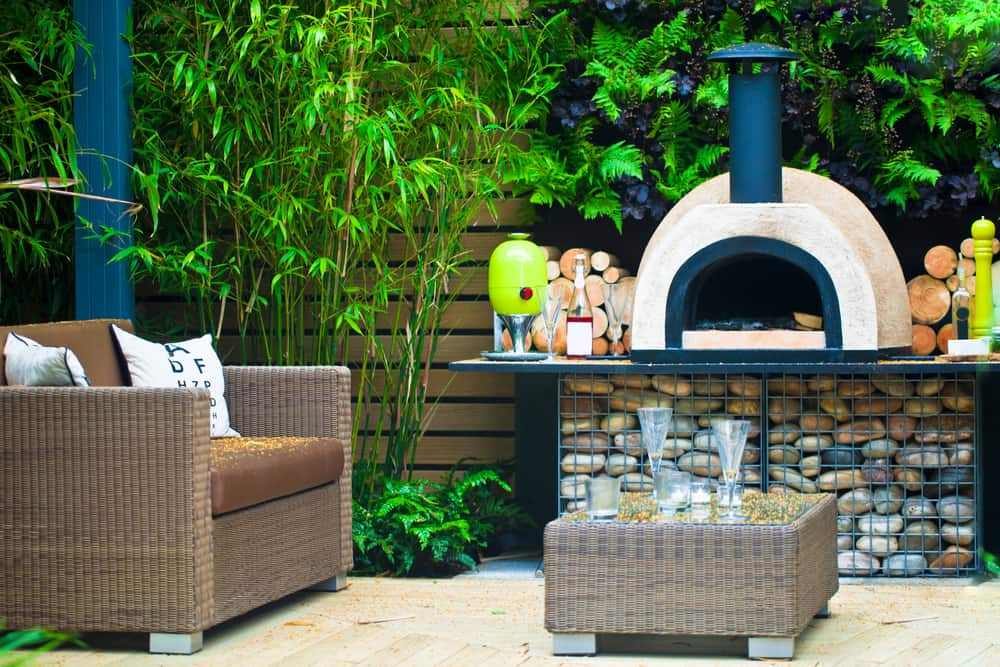 pizza oven in luxurious outdoor area for warmth and heat